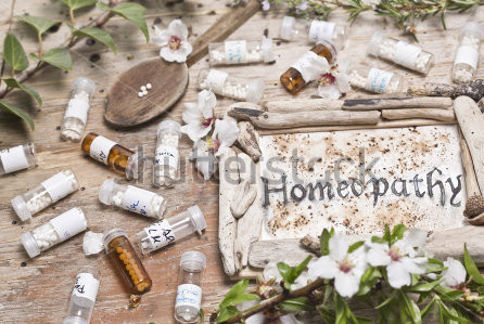 stock-photo-table-with-handwritten-text-homeopathy-spoon-homeopathy-globules-and-flowers-262316750